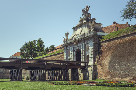 Alba Iulia, Romania - July 24, 2016: Third gate of Alba Carolina Citadel, the largest gate of the seven gates of the fortification, dominated by an equestrian statue of emperor Carol VI of Austria. Editorial