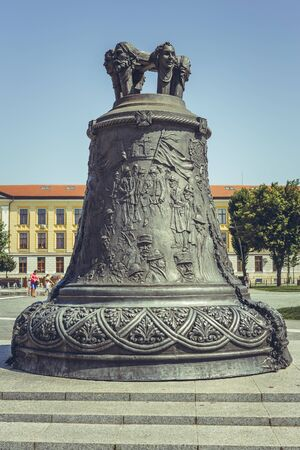 bell bronze bell: Alba Iulia, Romania - July 24, 2016: Big bronze broken bell sculpture in Alba Carolina Citadel square symbolizing the Great Union of Transylvania with the Kingdom of Romania in 1918. Editorial