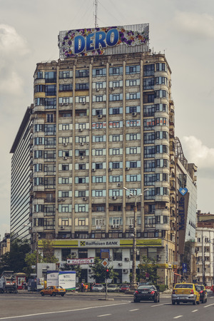 Bucharest, Romania - May 18, 2014: High-rise residential block of flats with large advertising billboard in the Victory Square (Piata Victoriei), a major intersection in central Bucharest. Editorial