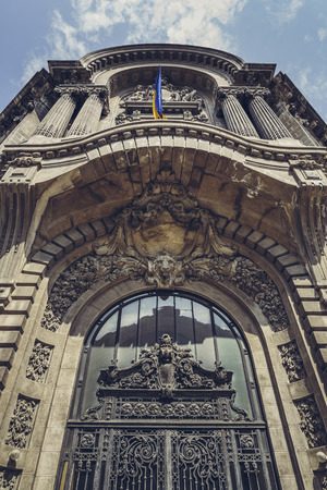 sumptuous: Bucharest, Romania - April 22, 2014: Upwards perspective of the Stock Exchange Palace sumptuous ornamental facade decorated in classic French style with Corinthian style columns and pillars. Editorial