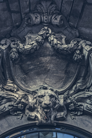 sumptuous: Bucharest, Romania - October 3, 2013: Architectural detail of stone carved ornaments with lion head on the sumptuous classic French style frontispiece of the Stock Exchange Palace.