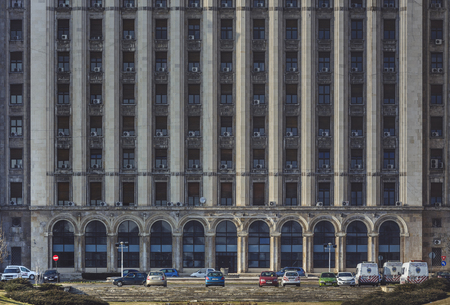 headquarter: Bucharest, Romania - March 9, 2013: House of the Free Press facade, a Stalinist style building opened in 1956 in northern side of the city, now headquarter of several printing presses.