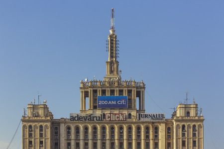 Bucharest, Romania - March 9, 2013: Architectural detail with top of the House of the Free Press (Casa Presei Libere), the former Casa Scanteii. Editorial