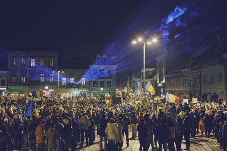 amnesty: Brasov, Romania - February 4, 2017: Tens of thousands of people peacefully protest in the Council Square against the controversial emergency ordinance on amnesty and pardon law. Editorial