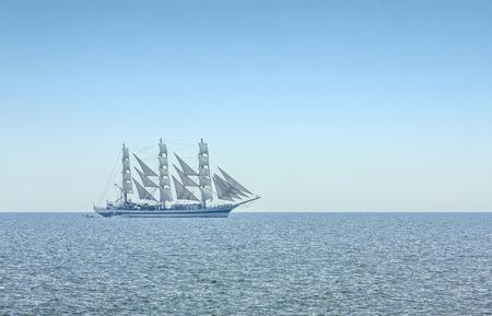 Three masted windjammer in full sails on the Black Sea on the horizon. Stock Photo