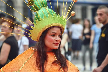 Bucharest, Romania - May 29, 2014: Portrait of Caucasian female dancer in exotic vivid carnival outfit performing The Giant Flowers show during the B-Fit International Street Theater Festival.