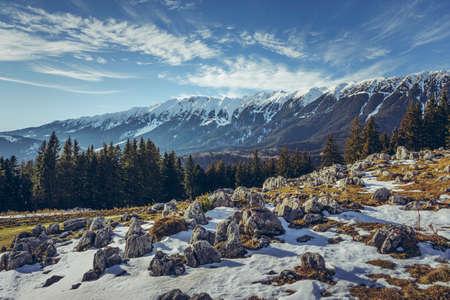 Alpine winter landscape with melting snow up in Zanoaga meadow, Piatra Craiului mountains, Romania. Stock Photo
