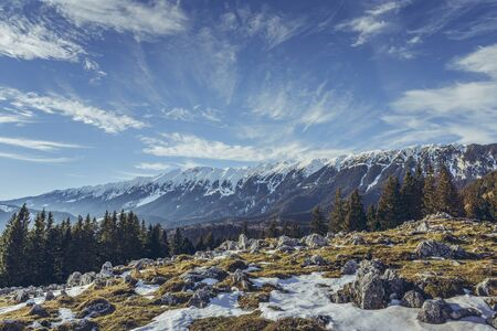Idyllic alpine winter landscape with Zanoaga meadow, Piatra Craiului mountains, Romania. Stock Photo