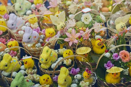 Knitted baskets filled with handmade figurines of Easter bunnies, chicks and floral ornaments on display in the gifts and crafts market.