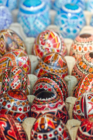 Beautiful colorful homemade ornate, painted decorative Easter eggs. Closeup, shallow depth of field, selective focus.