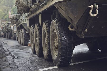 Brasov, Romania - May 14, 2015: American convoy of troops and heavy wheeled armored vehicles pass through Brasov city and head to Cincu to take part in an international drill.