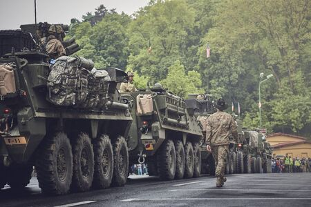 Brasov, Romania - May 14, 2015: American convoy of troops and wheeled armored vehicles march through Brasov city on their way to Cincu to take part in an international military exercise. Editorial