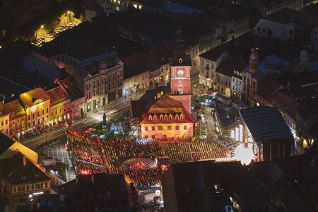 Brasov, Romania - September 1, 2018: Twilight aerial view of the Golden Stag (Cerbul de Aur) International Festival at its 50th anniversary, in the Council Square of Brasov city, Romania. Editorial