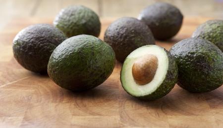 avocados: Avocados on a wooden chopping borad