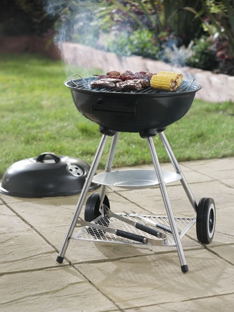 Barbecue in garden setting, portrait format Stock Photo