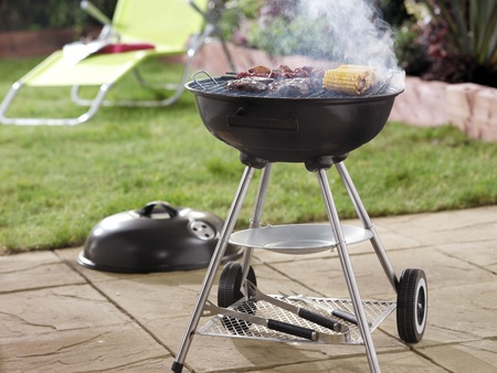 steak grill: Barbeque in garden setting, landscape format Stock Photo