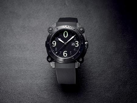 Gents wrist watch on dark textured background photo