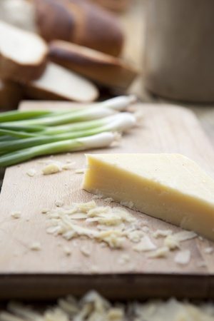 Mature cheese on wooden board Stock Photo
