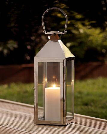Single garden lantern on a deck