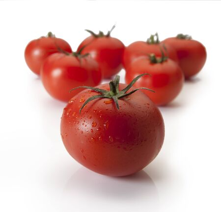 Juicy red tomatoes lined up like pool balls