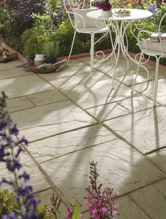 patio: Garden patio with white pistro table and chairs