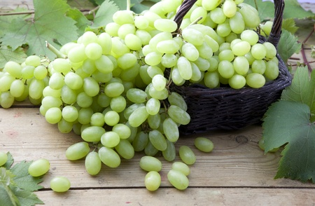White grapes on a wooden bench