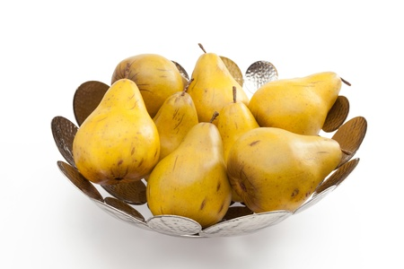 pears arranged in a contemporary silver bowl