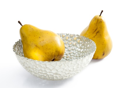 2 pears arranged around and in a contemporary silver bowl Stock Photo