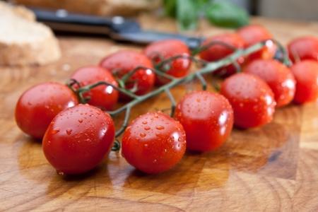 Freshly washed vine tomatoes Stock Photo