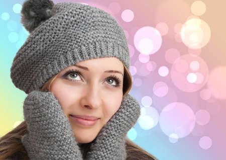Portrait of woman on bokeh background wearing woolen accessories