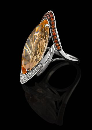 Precious Ring with brilliants and with topaz Stock Photo