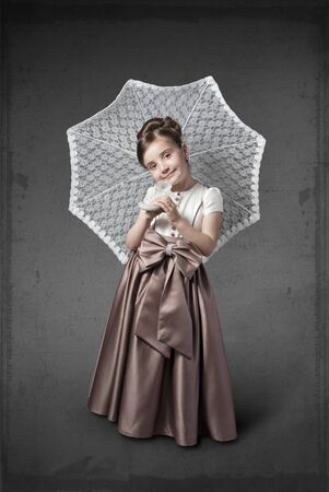Girl in a luxurious dress with an umbrella Stock Photo