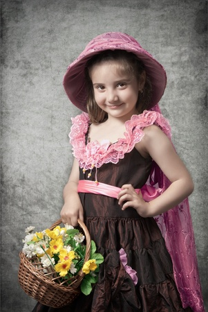 photo in retro style, the little girl with a basket flowers photo