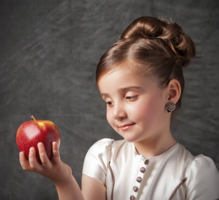 little girl holds red apple Stock Photo