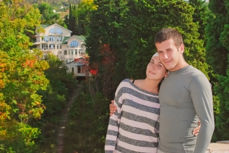 young couple on the background of a beautiful home Stock Photo - 15880469