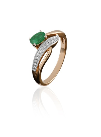 gold ring with an emerald and diamond isolated on white