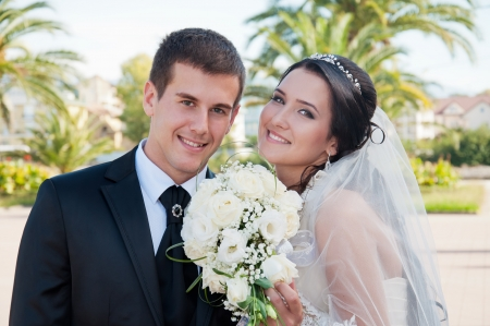 Wedding day  bridegroom and bride on background of the green palms Stock Photo
