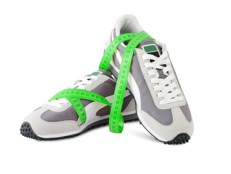 sports shoes for running with a roulette isolated on the white photo