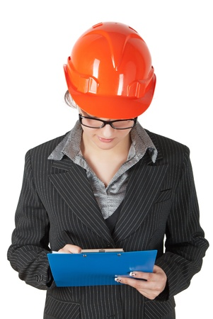 superintendent: female superintendent in the construction helmet records the tablet Stock Photo