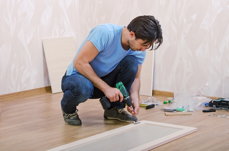 man collects new furniture Stock Photo