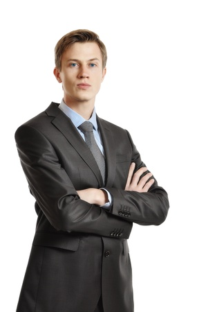 Young handsome businessman in black suit and tie isolated on white background