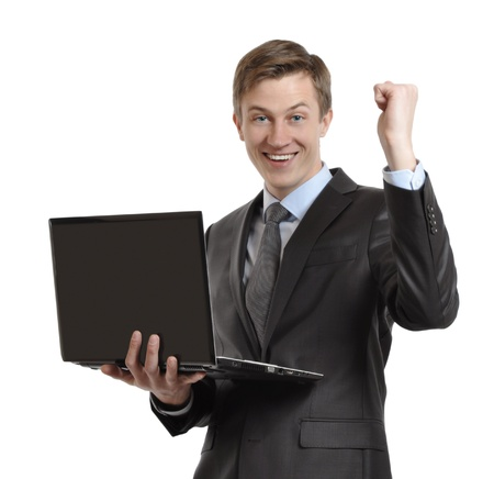 businessman with laptop celebrating victory with clenched fists and raised his hand  isolated on white