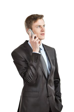 Businessman talking on a mobile phone  isolated on white Stock Photo