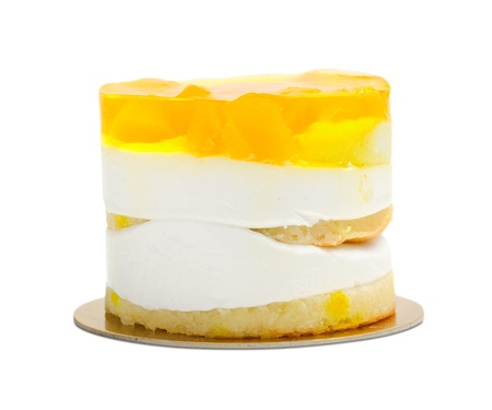 cake with cream and yellow fruit jelly
