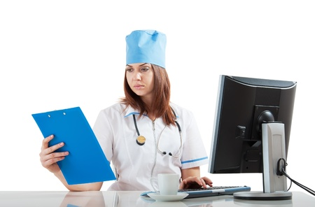 concludes: Doctor workplace at the computer looking at the results of the thinks Stock Photo