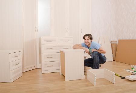 smiling carpenters of installing furniture