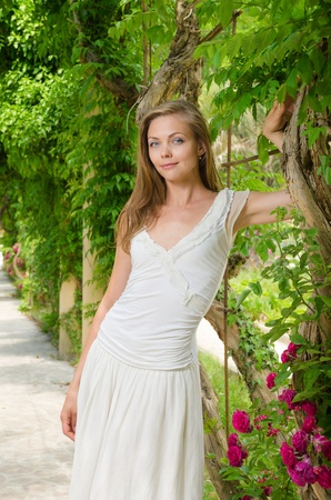 beautiful woman in white dress among the plants flower in summer  park Stock Photo - 19761534
