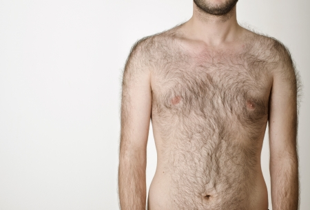 hairy male torso on a white background Stock Photo