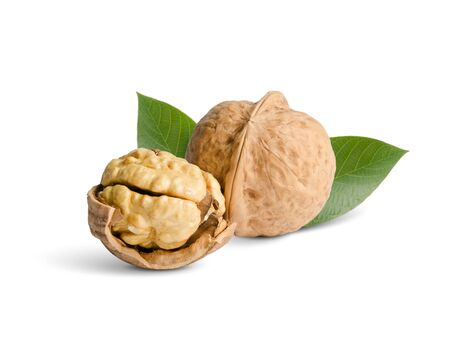walnuts with green leaves close up, isolated on white Stock Photo