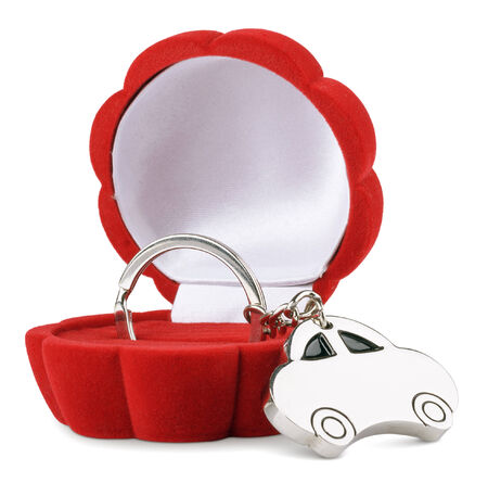 keychain car in red gift box  isolated on white
